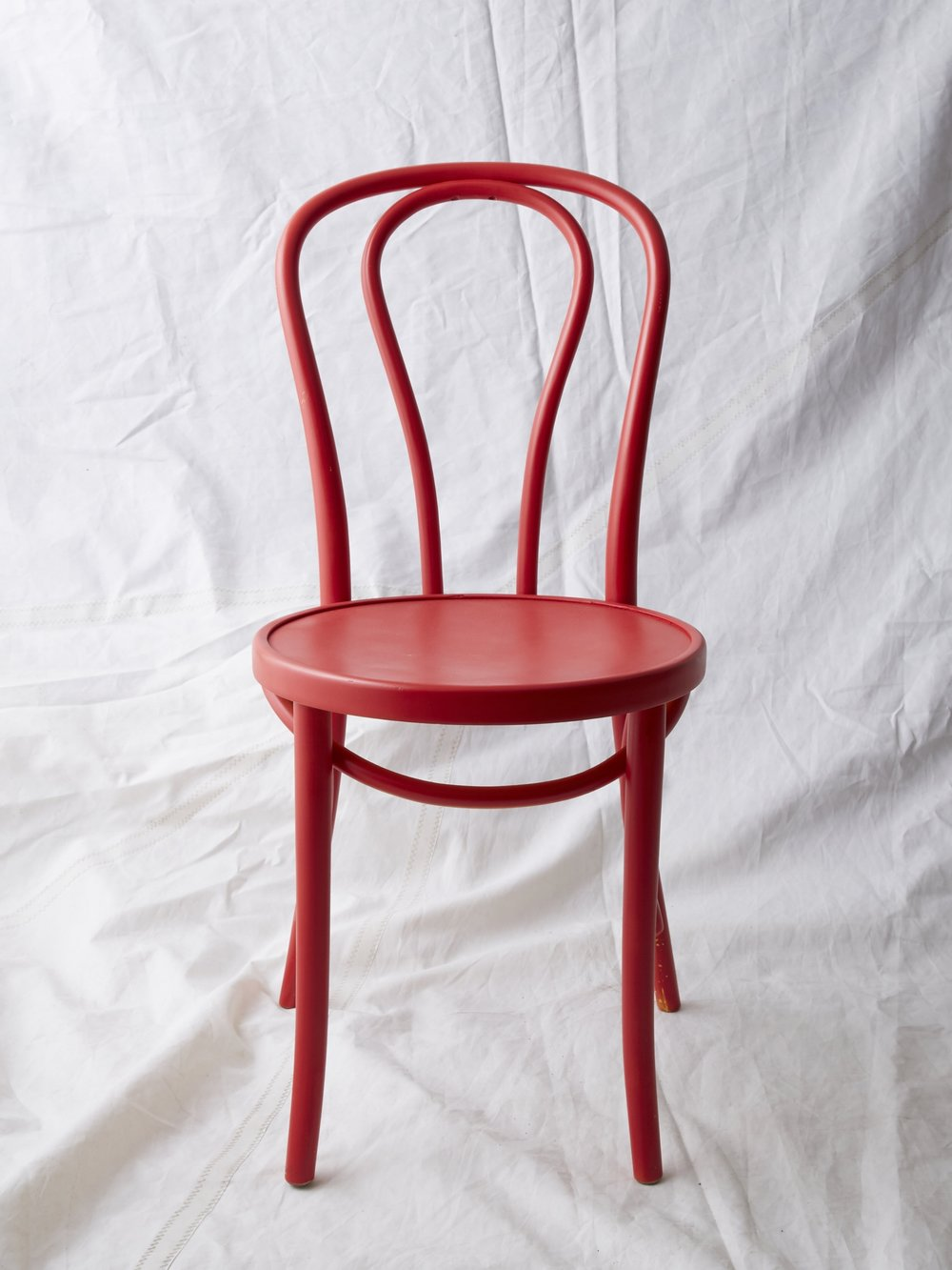 "CH024  Red painted Thonet chair 35"" H x 16"" W x 20"" D  $75/week"