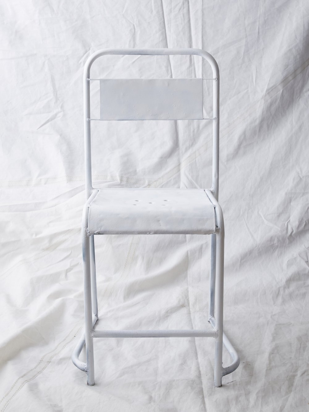 "CH038 Matte white painted steel 33"" H x 14"" W x 16"" D $75/week Set of 1"