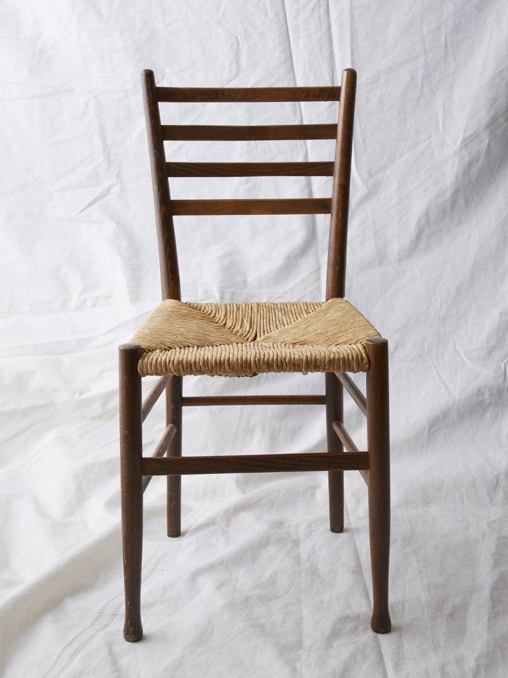 """CH040 Wood chair with wicker seat 33"""" H x 16"""" W x 17"""" D $75/week"""