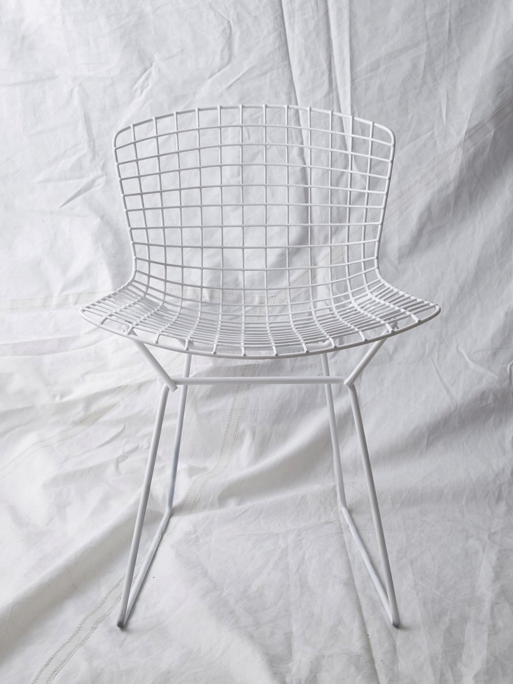"CH016  White vintage Bertoia side chair 29"" H x 21"" W x 22"" D  $150/week"