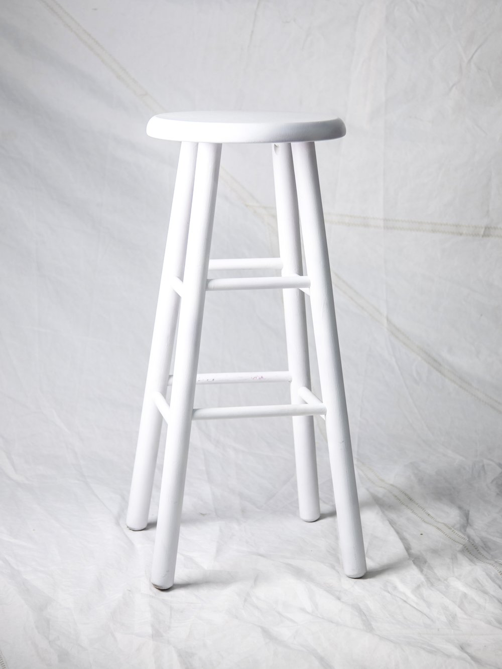 "ST042  WHITE WOODEN STOOL 13"" DIA x 30"" H  $95/week"