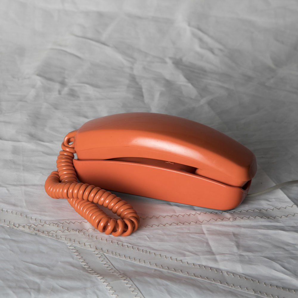 ORANGE PUSH BUTTON PHONE