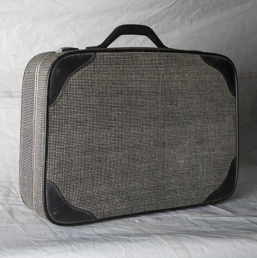 "LUGGAGE 05 BLACK W/ WHITE MOIRE SUITCASE, CIRCA 1960 21"" L x 16"" W x 6"" D"