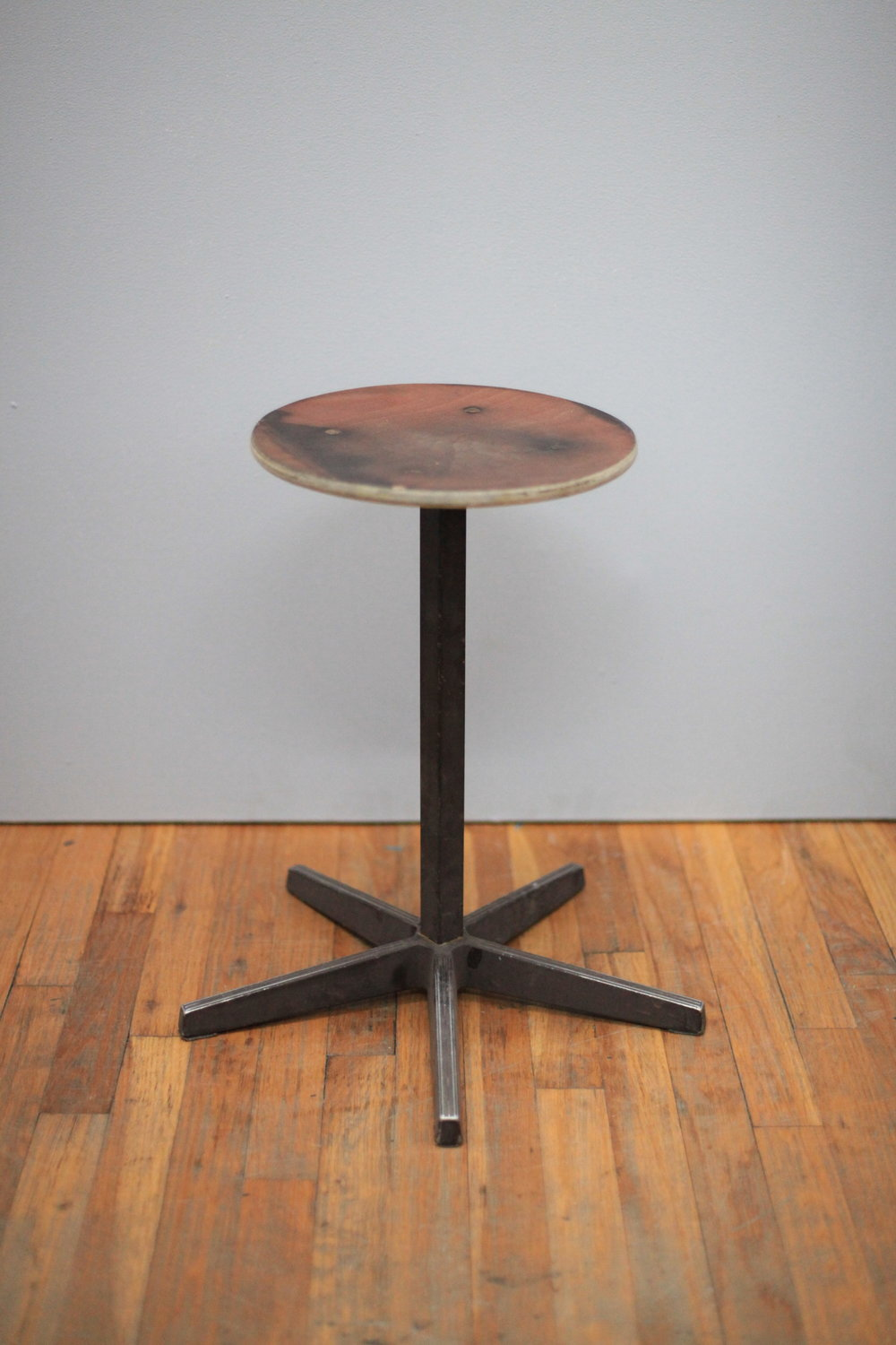 ST018  Wood with metal asterisk base stool  Made in Holland  $150
