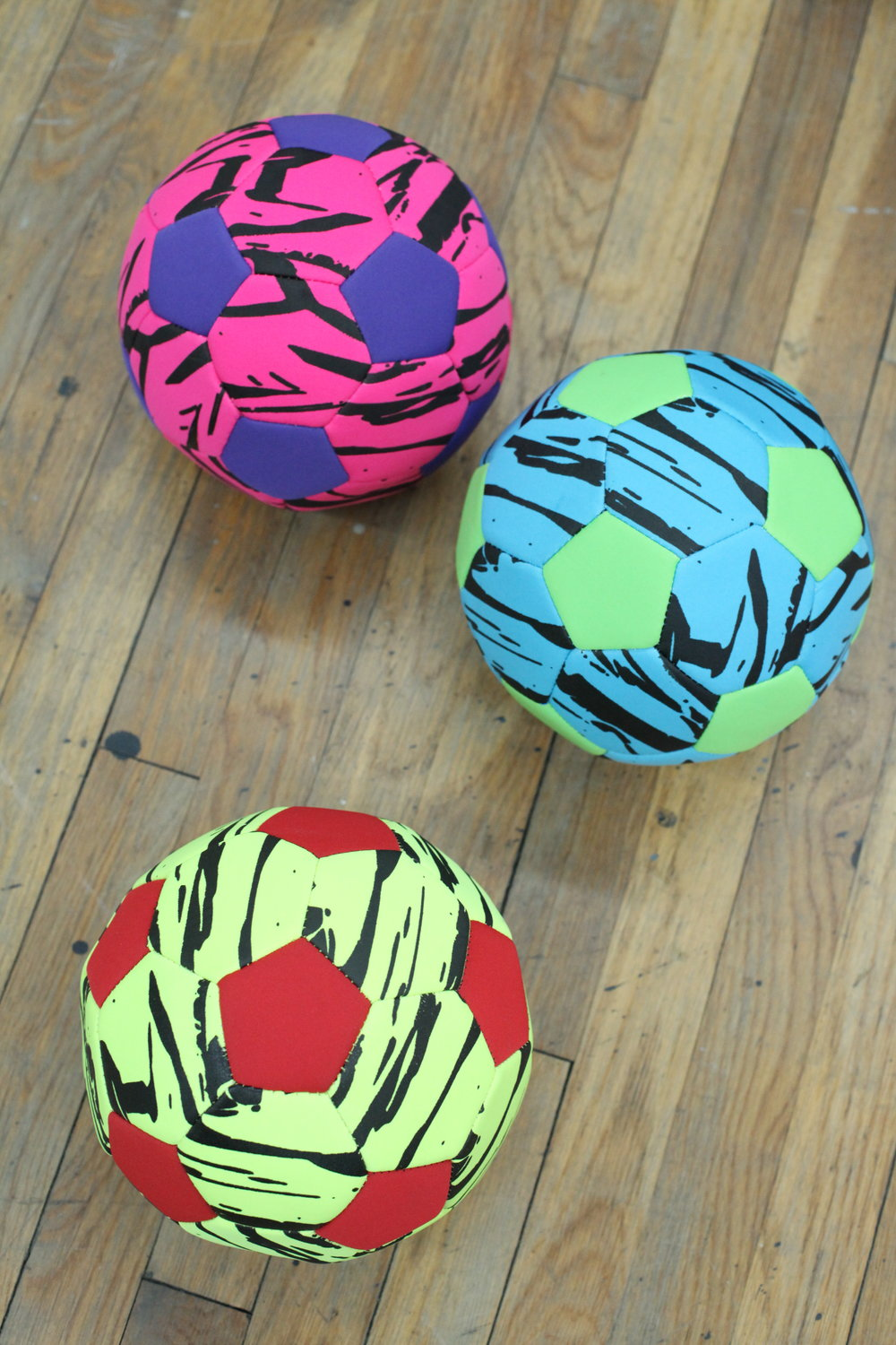 "CHECK OUT THESE NEW NEOPRENE SOCCER BALLS!  VERY ""90'S BODY GLOVE"""