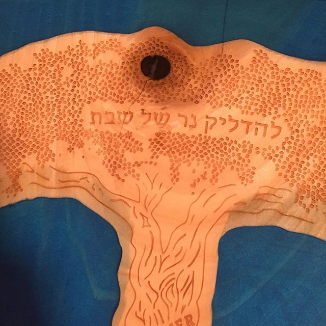 Specially ordered tray for Shabbat candle lighting.  Laser engraved tree surrounded by blue resin.  #customengraving #shabatshalom #4shabbatcans #judaica #familytree #shabbsydsbvg #jewishfamily #pouringresin #shabbatcandles #candletray #jewishweddingfuk#makeanimpression #impressionjudaica
