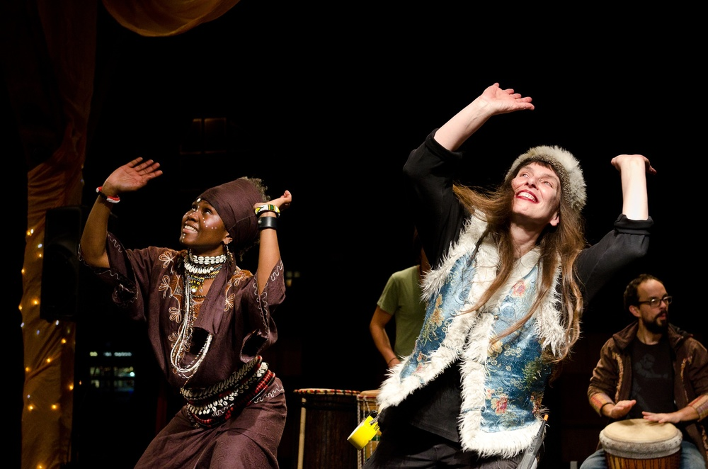 Jacky Arah Yenga dancing with Artistic Director Naomi Singer on the Solstice Stage.