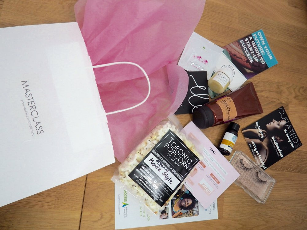 Curated Life's signature event gift bags with samples from our in-kind sponsors