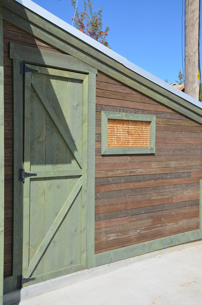 The old barn wood was reclaimed and reused for the siding of the workshop.