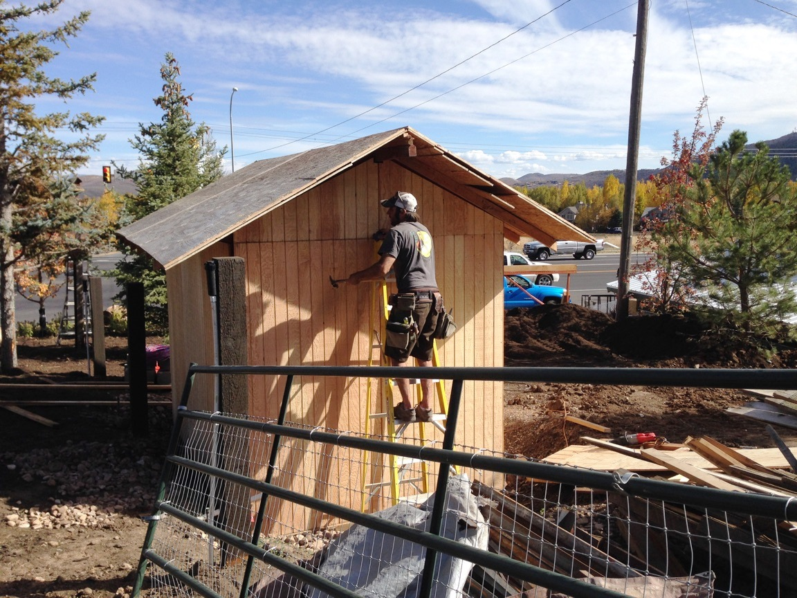 Joe working on the front small barn structure.