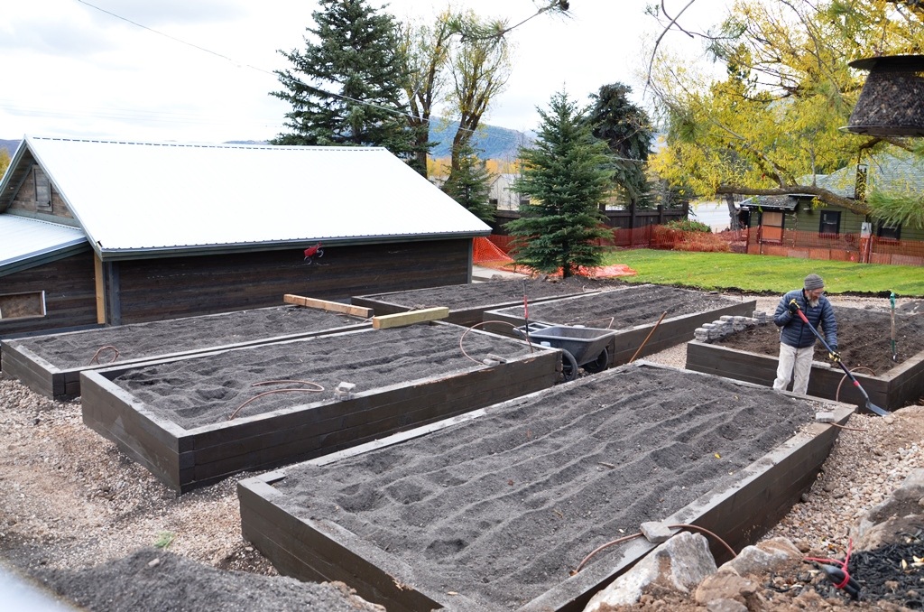 The garden beds have been stained and filled with dirt, ready for action this next Spring!