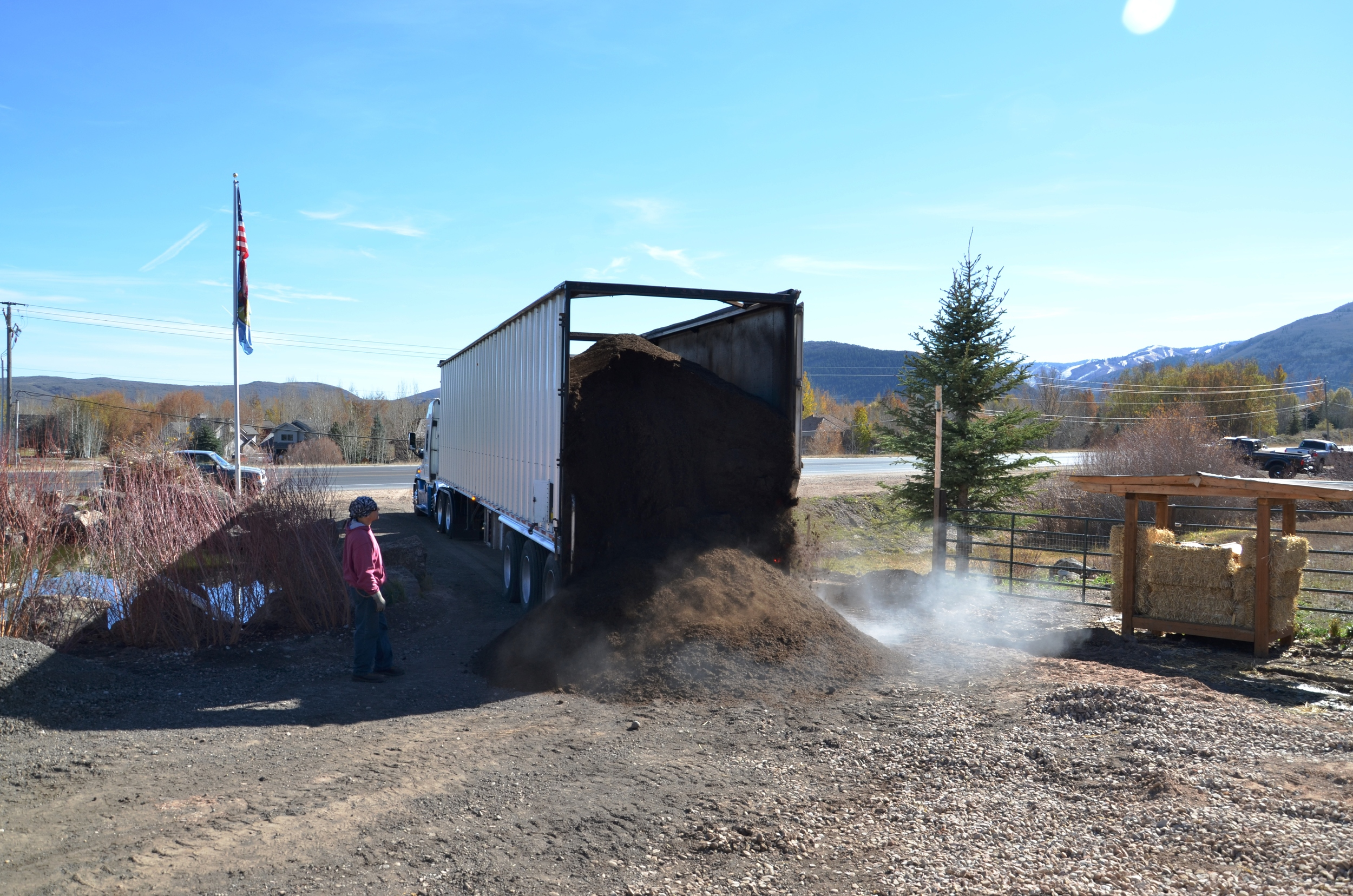 Unloading dirt to be used on surrounding areas around the Bill White Farms to help beautify and restore the vegetation and landscape.