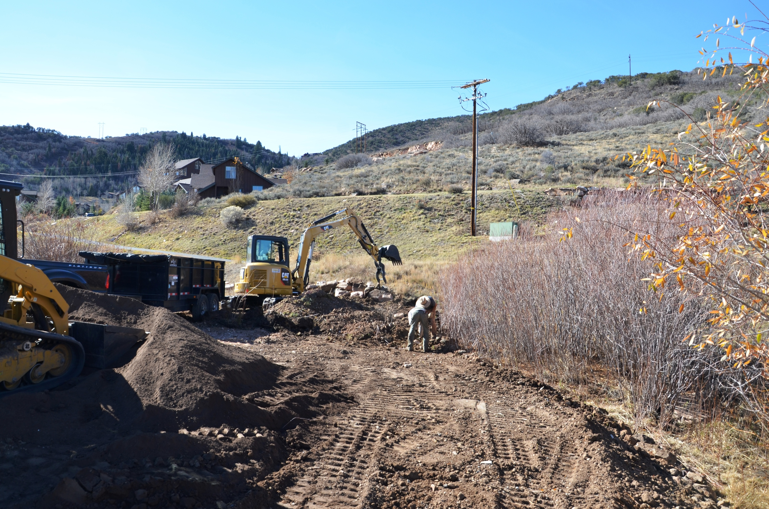 Bill, Ryan and Brian working on cleaning up and restoring beauty to the surrounding areas around the Bill White Farms.
