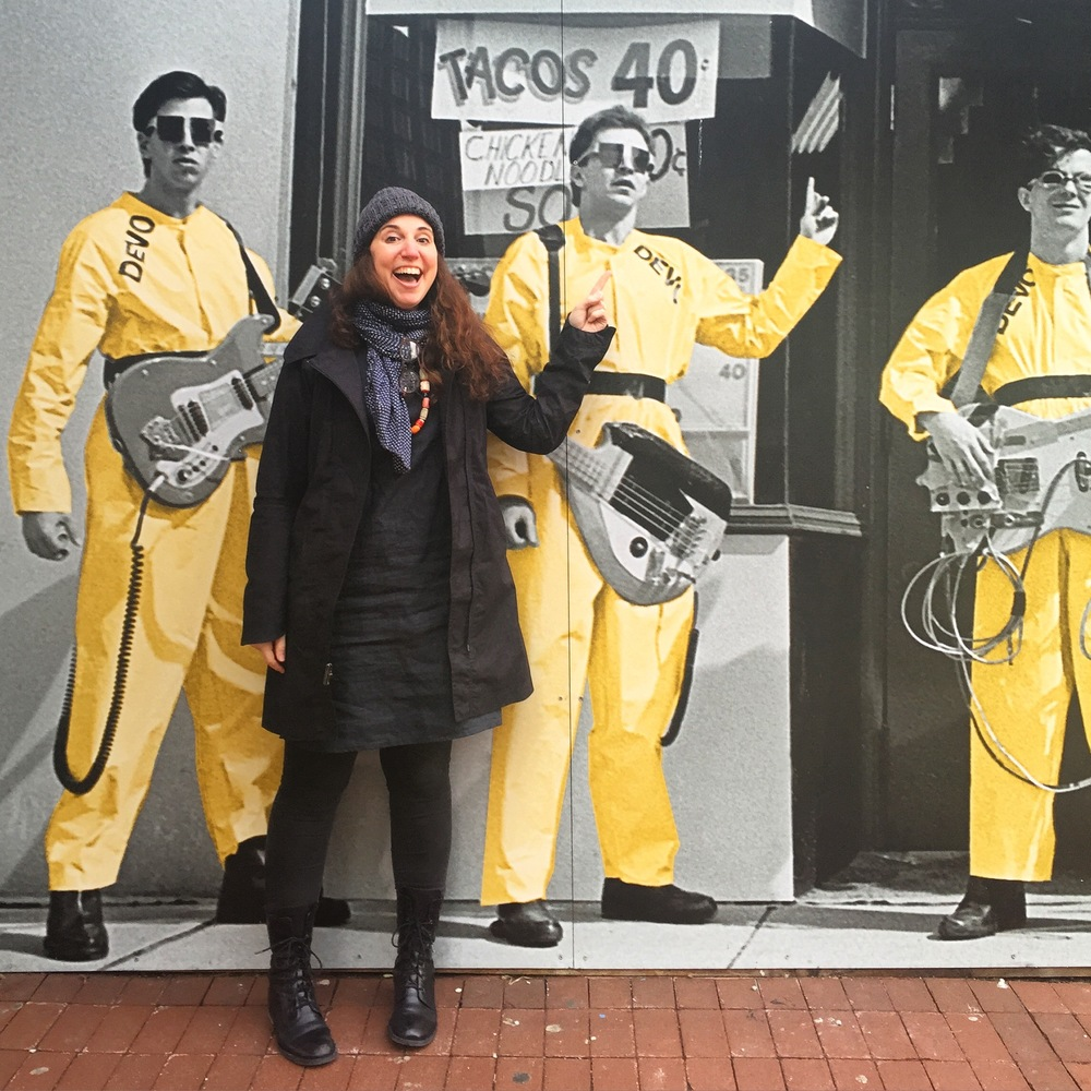 Have zines will travel:  I love visiting universities to  speak  and work with students. (Here I am on a recent trip to the University of Akron completely nerding out with the DEVO mural downtown.)   I have presented my work in an expansive set of contexts including contemporary art galleries, alternative artist spaces, colleges and universities, the lectern at creative conferences worldwide, book stores and stuff shops, and the walls of the offices of select creative companies.