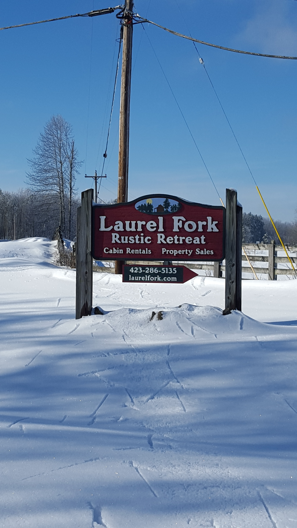 Snowy Laurel Fork Rustic Retreat sign