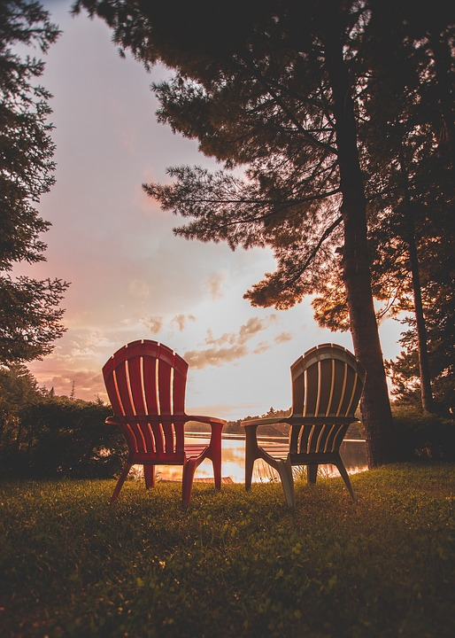 lawn chairs at sunset