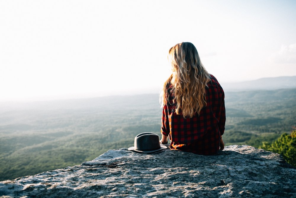 Sitting on the edge of an overlook
