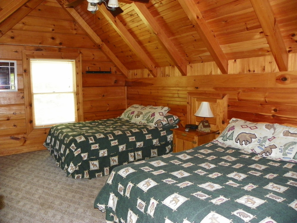 Two queen beds inside Laurel Cove cabin