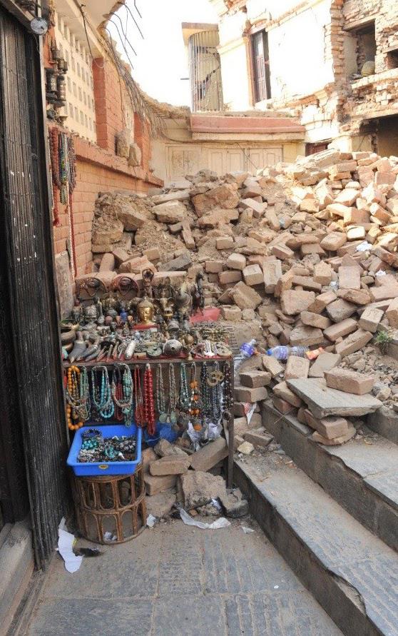 tk nepal 2016 cor kathmandu collapsed building souvenir stand.jpg