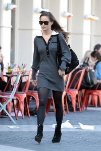 Pippa Middleton sports her ankle boots with a sleek grey dress and tights   via   Stylebistro