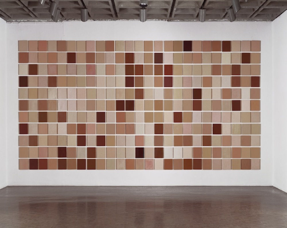 Installation view of Byron Kim, Synecdoche,1991–present, oil and wax on wood, each panel: 10 x 8 inches, overall installed: 120 1/4 x 350 1/4 inches, Whitney Museum of American Art, NY.
