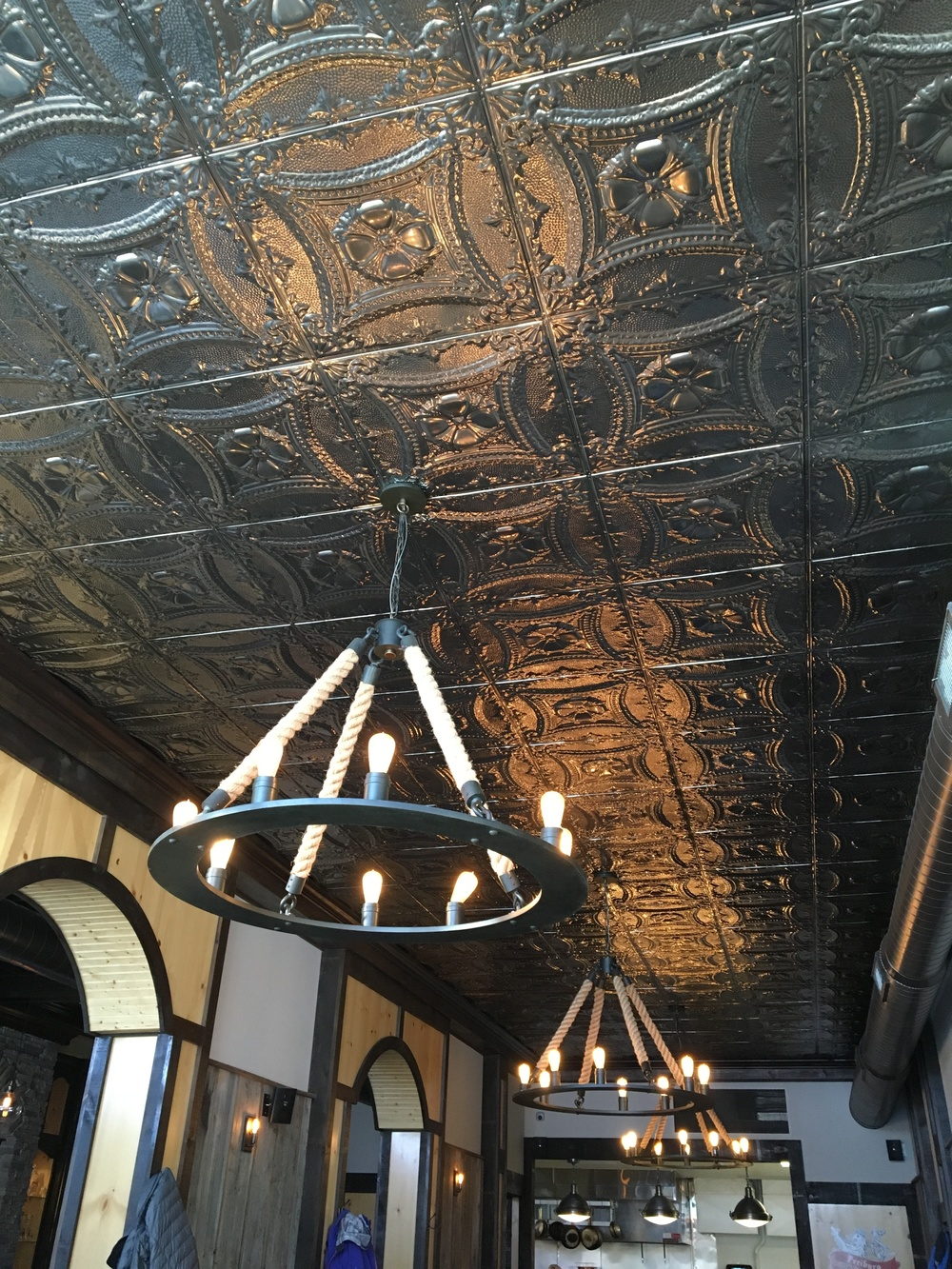 Tin ceiling & rustic style fixtures at Freiburg Gastropub                                                                                                                    Photo by Epicurean Chronicles