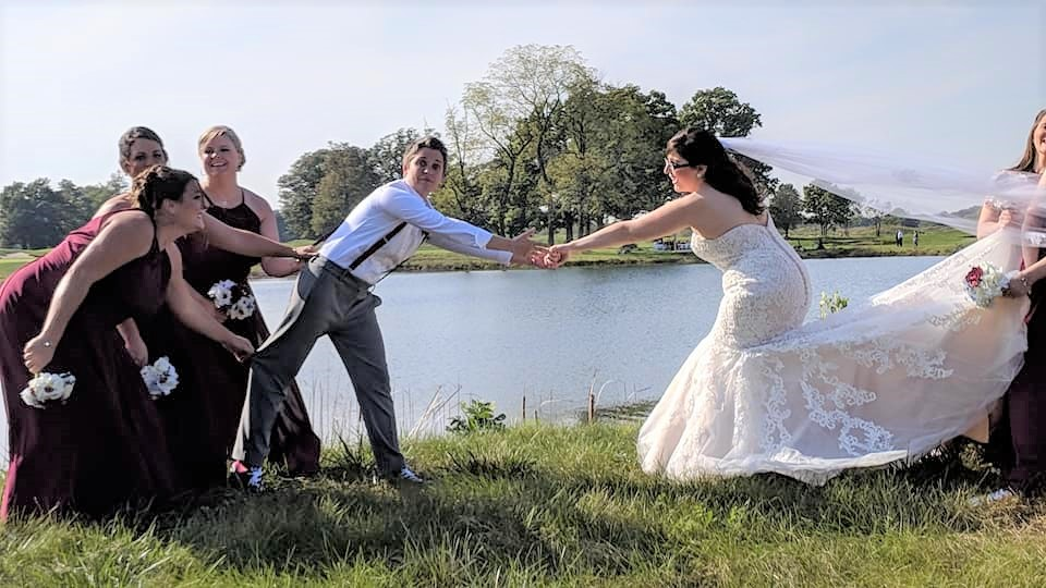 Love is a tug of war—and everybody wins!  Venue: Purgatory Golf Club, Noblesville, IN  Photo: Sweet Cheeks Photography