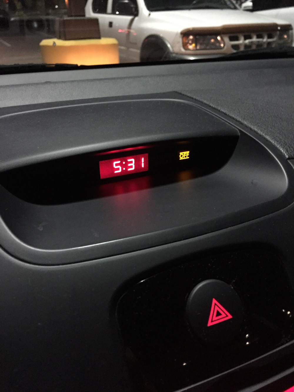 This is what my car's clock looks like in a Planet Fitness parking lot at 5:31 a.m.
