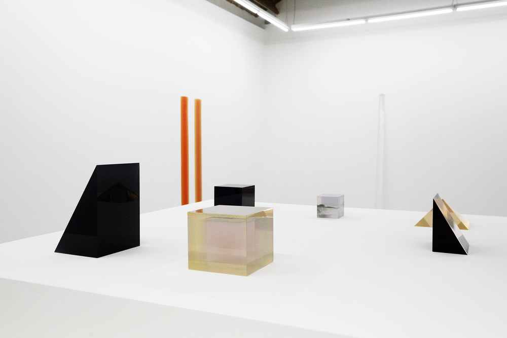 Installation view of selection of Peter Alexander's resin sculptures in various translucent colors
