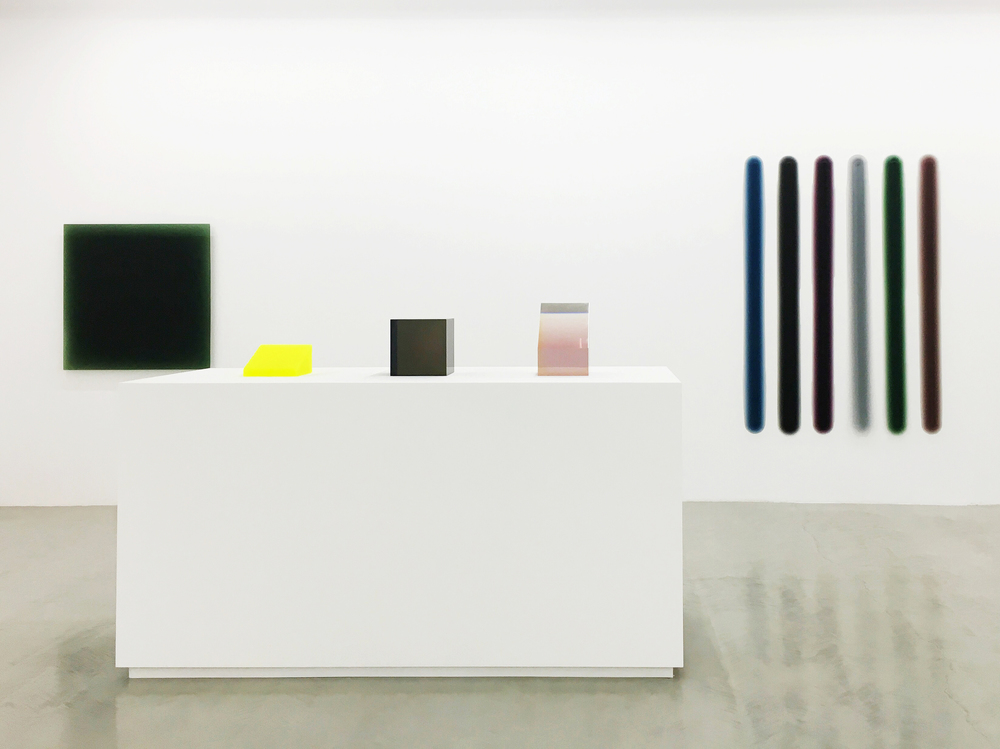 Installation view of Peter Alexander's various trasnlucent colored resin sculptures