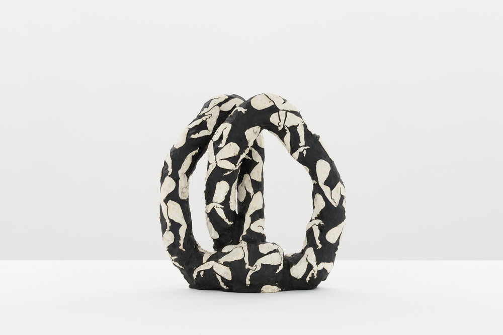 Julia Haft-Candell's Infinity: Legs black ceramic sculpture with raised white legs all over