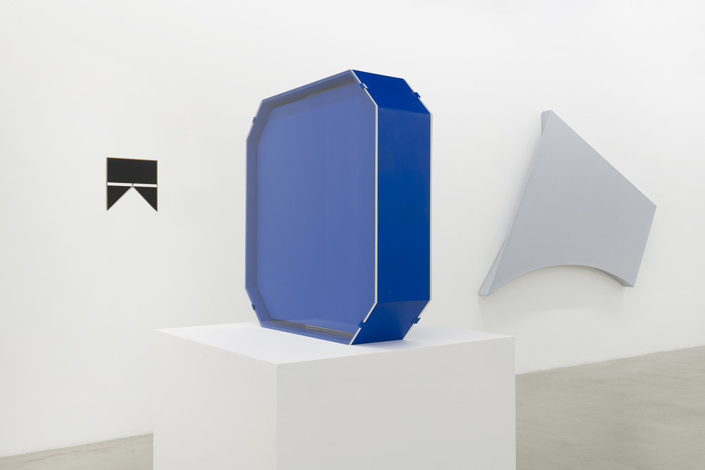 Installation view of Tony Delap: A Career Survey focusing on Charlier, an electric blue octagon sculpture made of stainless steel, wood, fiberglass, plexiglass and lacquer paint