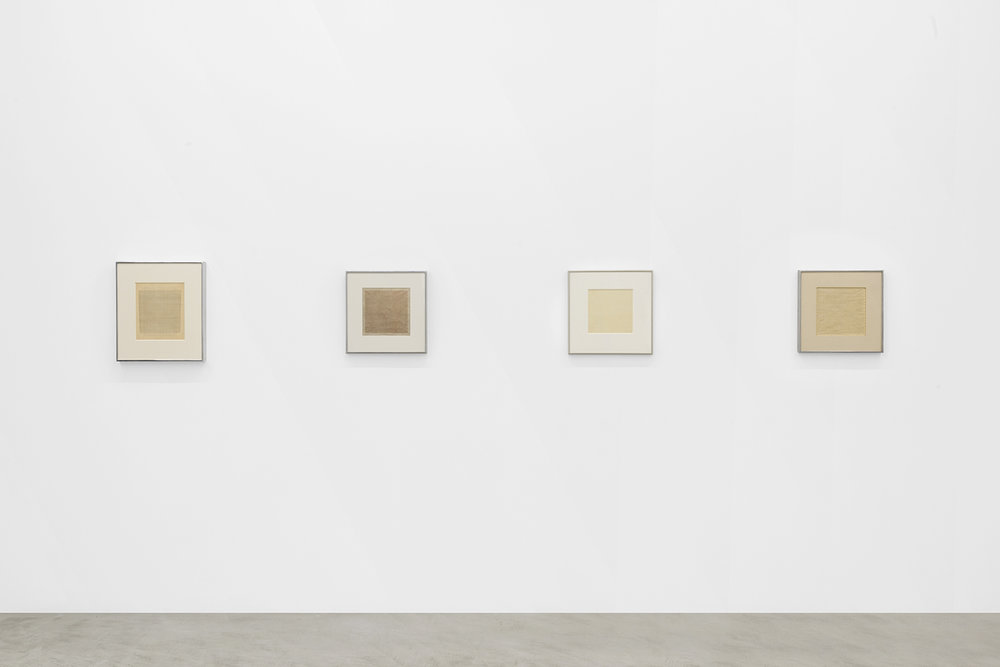 Installation view of four Agnes Martin works depicting various grid-like forms from the 1960s on paper