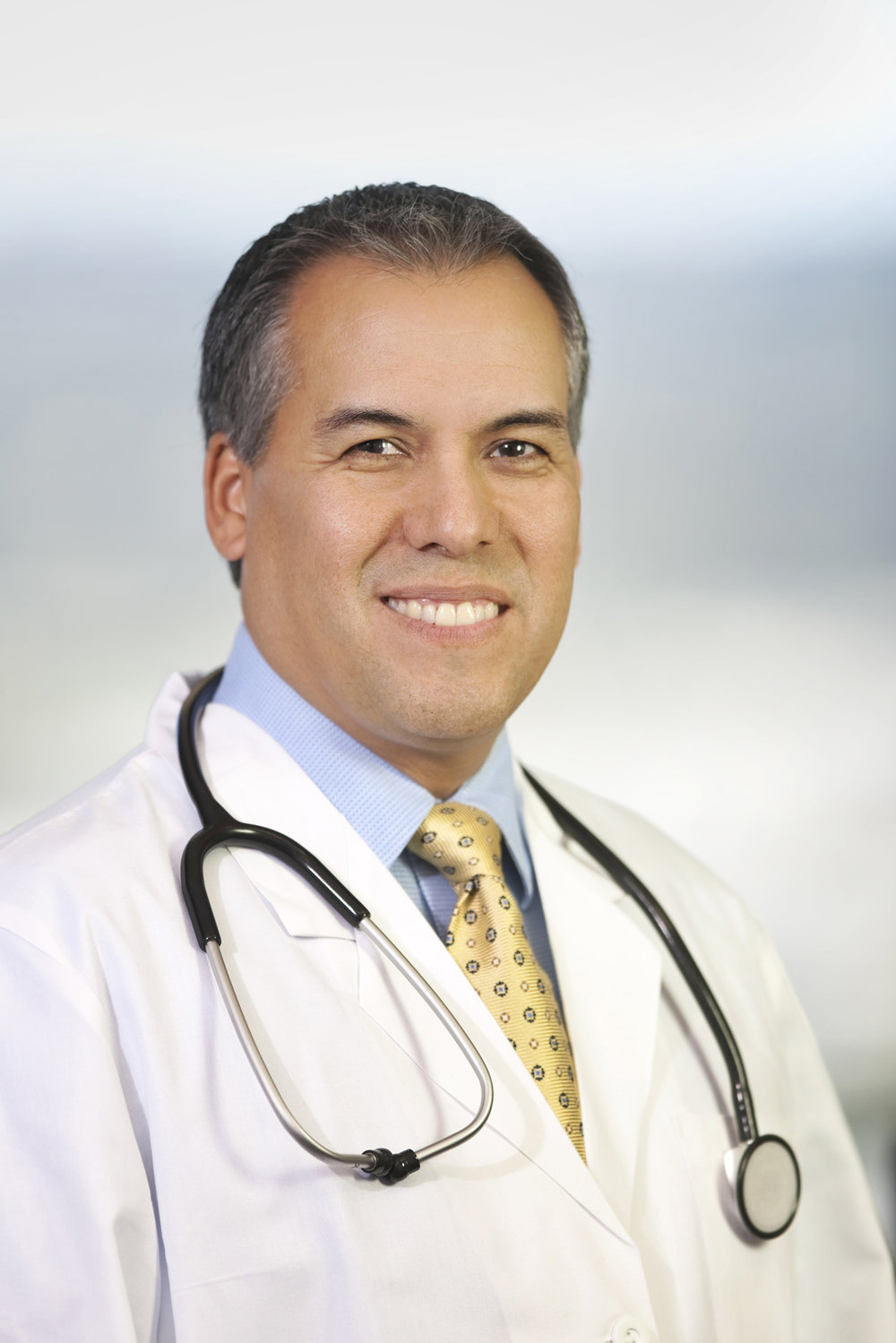 Headshot Portrait of Hispanic Medical Doctor