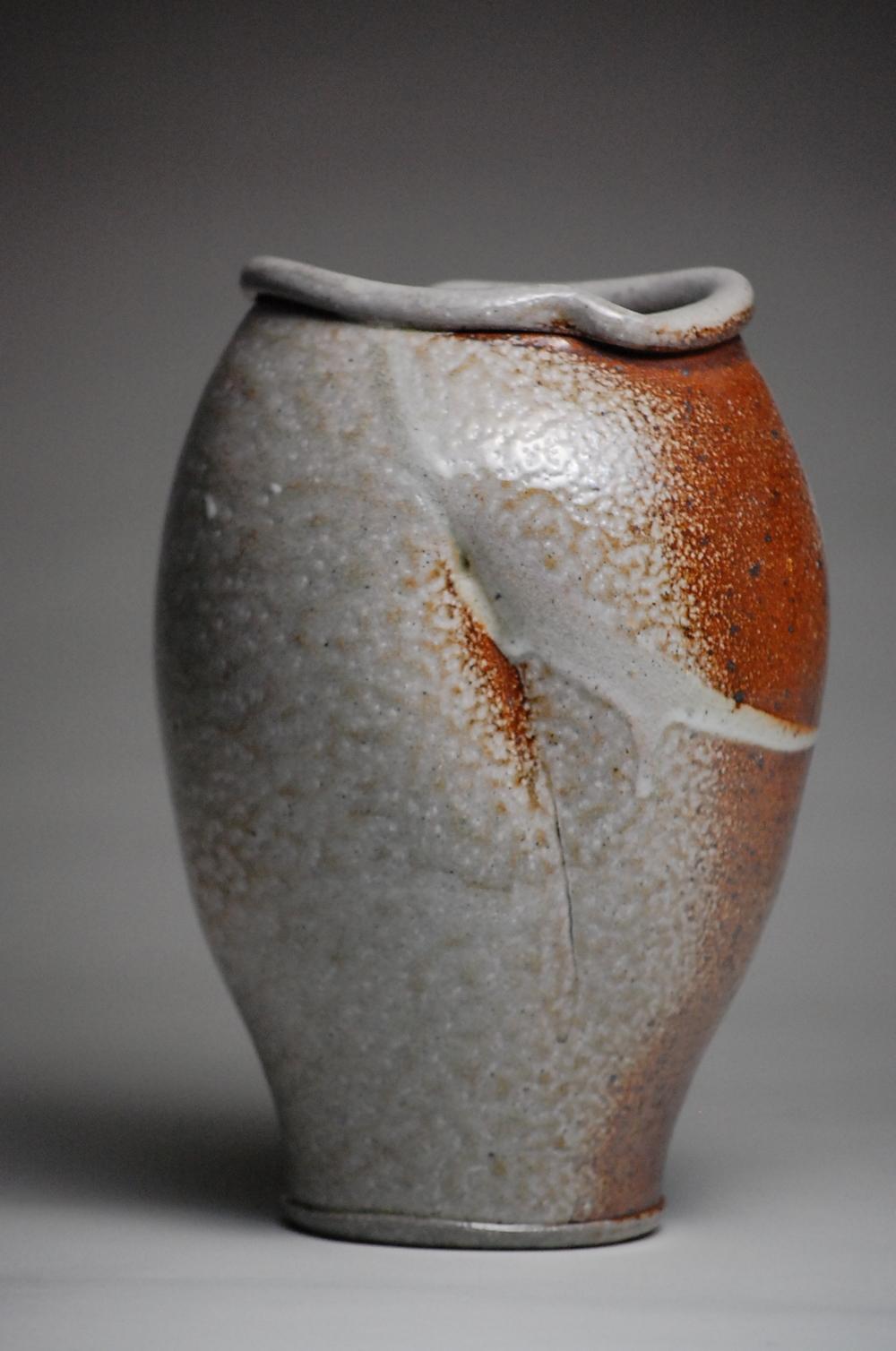 Soda Fired Vase with a Shino flashing slip. 7x8x12