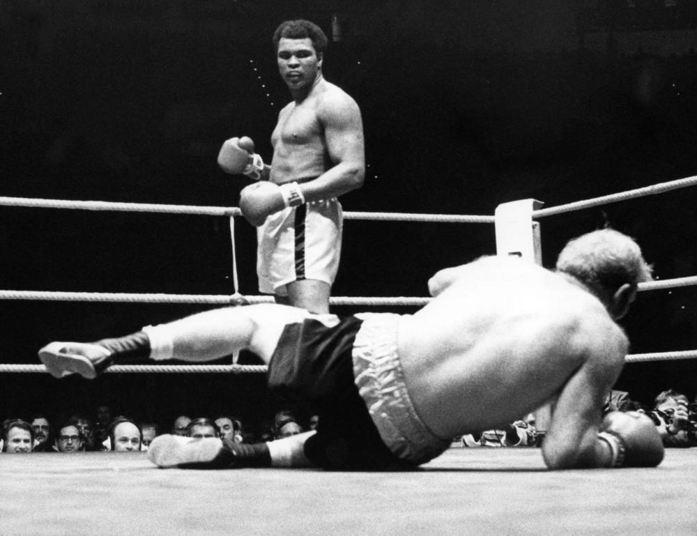 Heavy weight boxer Muhammad Ali seen after knocking-out his British challenger Richard Dunn in the fifth round of their fight, in Munich, Germany, on May 25, 1976. Born as Cassius Clay, boxing legend Muhammad Ali, dubbed as 'The Greatest,' died on June 3 in Phoenix, Ariz., at the age of 74. (EPA)