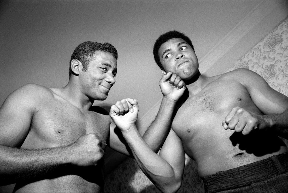 Muhammad Ali and Floyd Patterson pose after a pre-fight physical in New York, on Sept. 11, 1972. (Don Hogan Charles/The New York Times)