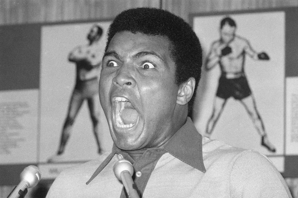 Muhammad Ali yells during a news conference in New York on Aug. 29, 1974. Ali, the magnificent heavyweight champion whose fast fists and irrepressible personality transcended sports and captivated the world, has died according to a statement released by his family on June 3, 2016. He was 74. (Ron Frehm/Associated Press)