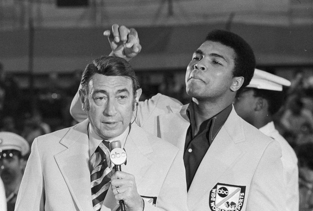 Muhammad Ali jokes with television sports commentator Howard Cosell before the start of the Olympic boxing trials, in West Point, NY., on Aug. 7, 1972. (Associated Press)