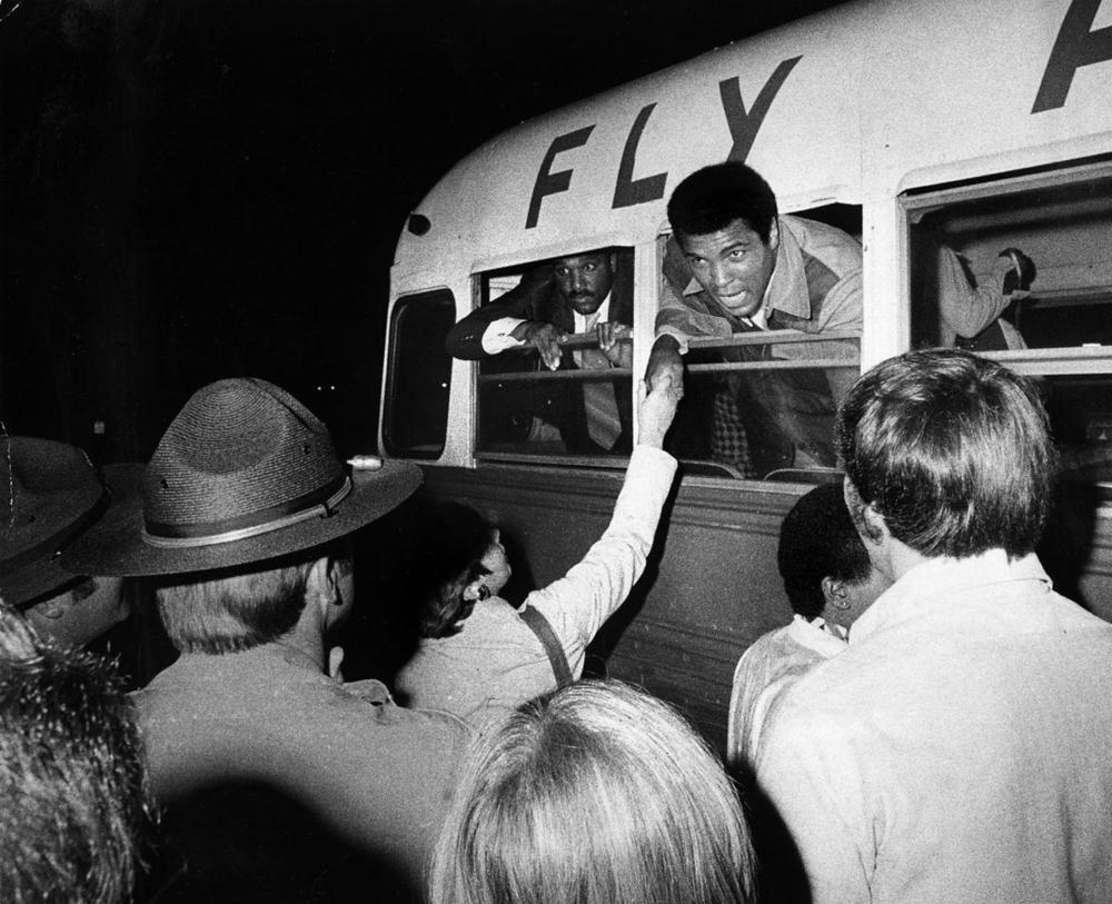 Muhammad Ali at Logan airport in Boston, talked to a crowd from his bus while changing planes. (John Blanding/Globe Staff)
