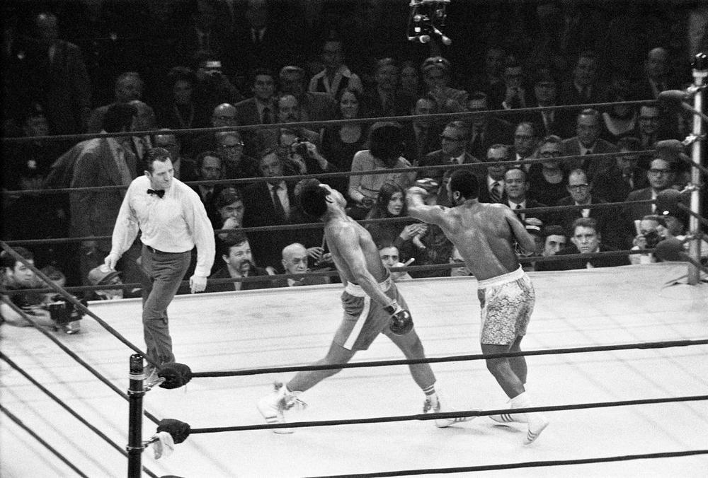 Joe Frazier (right) lands a left hook on Muhammad Ali during the first of their three epic battles at Madison Square Garden in New York City on March 8, 1971. The Fight of the Century (also known as The Fight) is the title boxing writers and historians have given to the boxing match between champion Joe Frazier (26-0, 23 KOs) and challenger Muhammad Ali (31-0, 25 KOs). (Action Images)