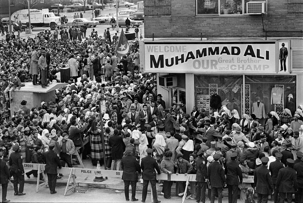A large crowd turns out as Muhammad Ali visited Harlem on Dec. 9, 1974. (Neal Boenzi/The New York Times)