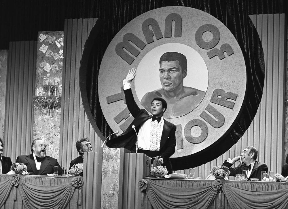 Orson Welles (from left), US actor-singer Dean Martin, and Sports announcer Howard Cosell laughing at US boxer Muhammad Ali during the Dean Martin Roast of Muhammad Ali at the MGM in Las Vegas, Nevada, on Jan. 18, 1976. (Las Vegas News Bureau via EPA)