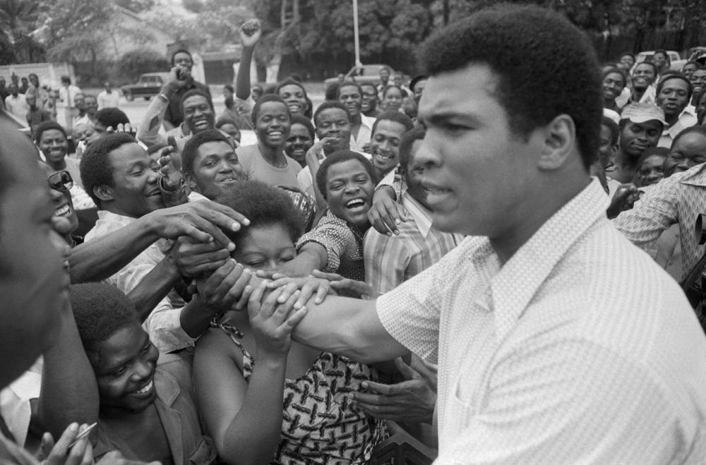 Muhammad Ali is greeted in downtown Kinshasa, Zaire on Sept. 17, 1974 who was in Zaire to fight George Foreman. (Associated Press)