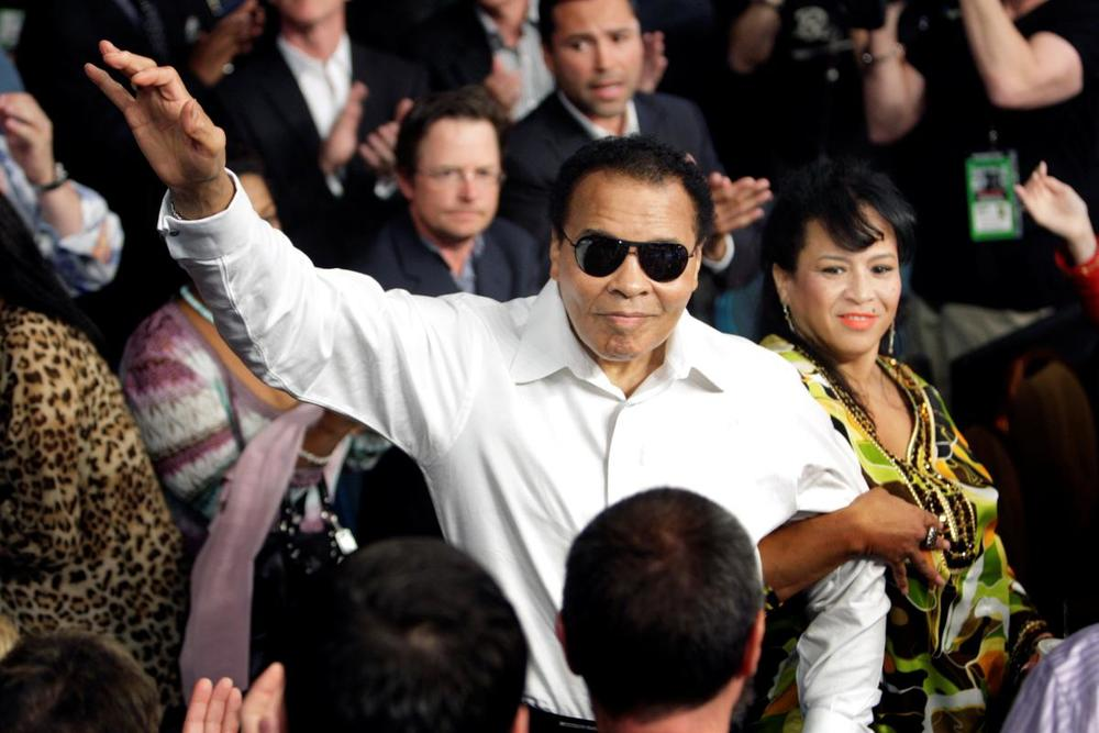 Boxing legend Muhammad Ali stands with his wife Yolanda as he is introduced before the welterweight fight between Floyd Mayweather Jr. and Shane Mosley at the MGM Grand Garden Arena in Las Vegas, Nevada on May 1, 2010. (Steve Marcus/Reuters)
