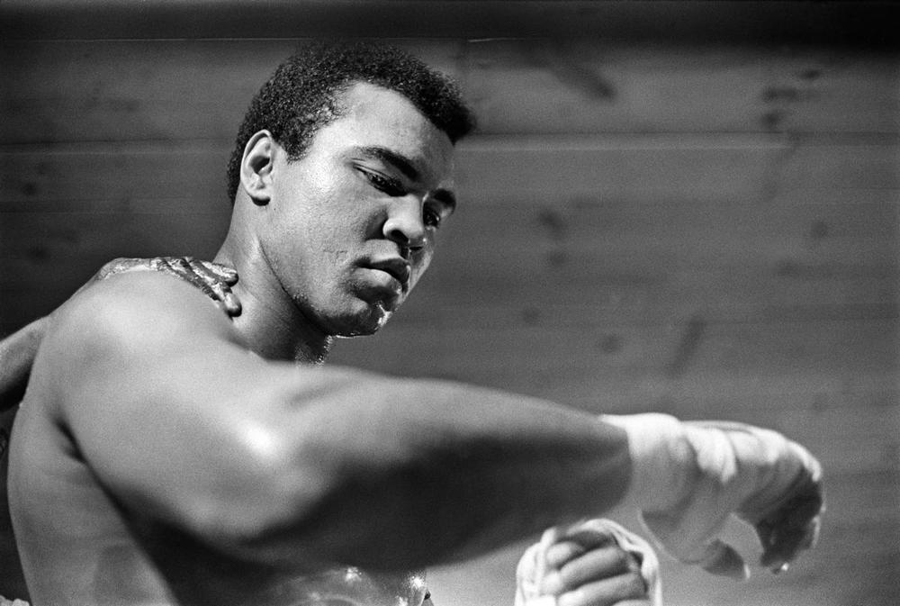 Muhammad Ali tapes his right hand for a training session at his camp in Deer Lake, Pa., on Jan. 17, 1974. (Robert Walker/The New York Times)