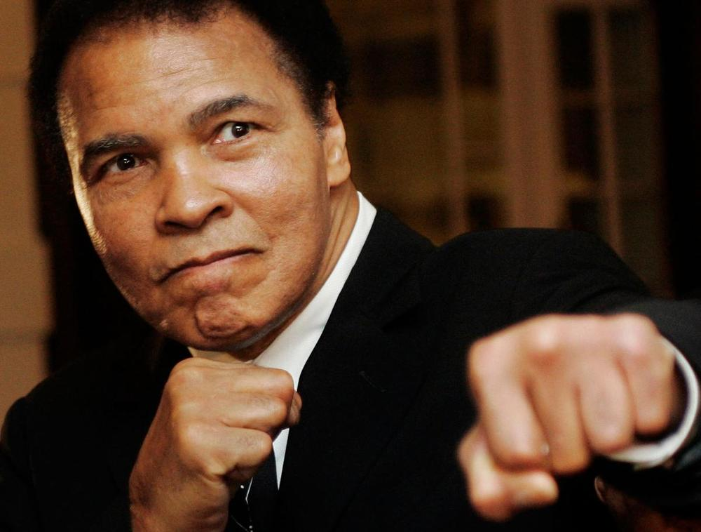 US boxing great Muhammad Ali poses during the Crystal Award ceremony at the World Economic Forum (WEF) in Davos, Switzerland on Jan. 28, 2006. (Andreas Meier/Reuters)
