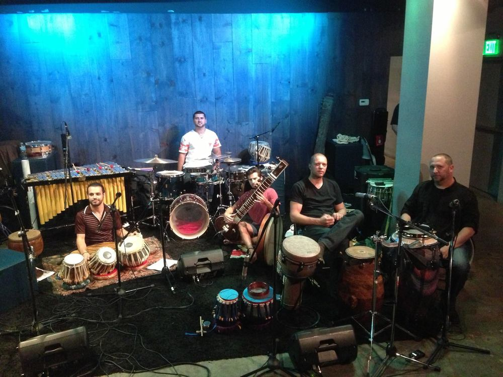 setting up for Hands On'Semble and Rhein Percussion  pictured: Will Marsh, Amir oosman, Andrew Grueschow, Randy Gloss.  at the Blue Whale, Los Angeles CA Sept 7th 2013.