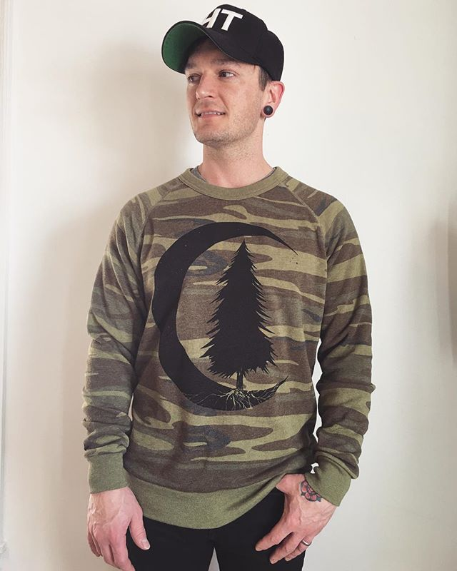Tomorrow is the last day to get a preorder in for any of the coveted camo woodland styles. This is the only way to get this sweatshirt, the pullover hoodie and the women's long sleeve pullover. Don't miss out! Link in profile to shop. . . . #acanthusapparel #unisex #sosoft #ecofleece #printalternative #screenprinting #printlife #desmoinesiow #desmoinesartist #familybusiness #camo #woodland #moon #tree #evergreen #tattooinspired
