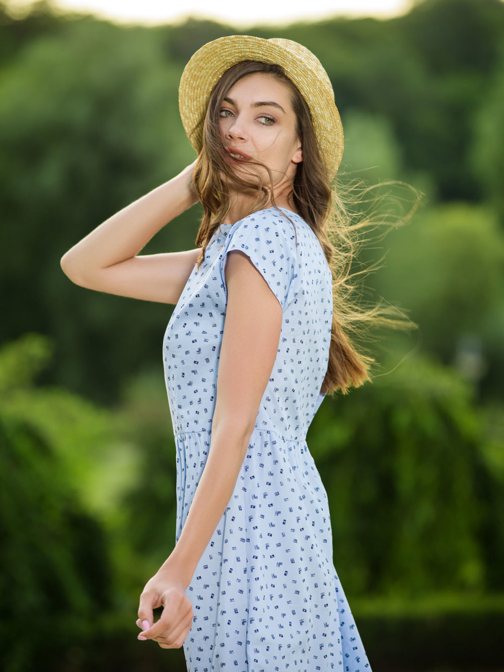 Beautiful young woman in a summer dress.